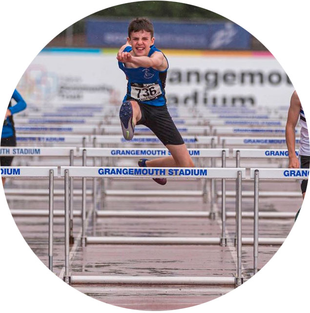 Boys competing in hurdles event