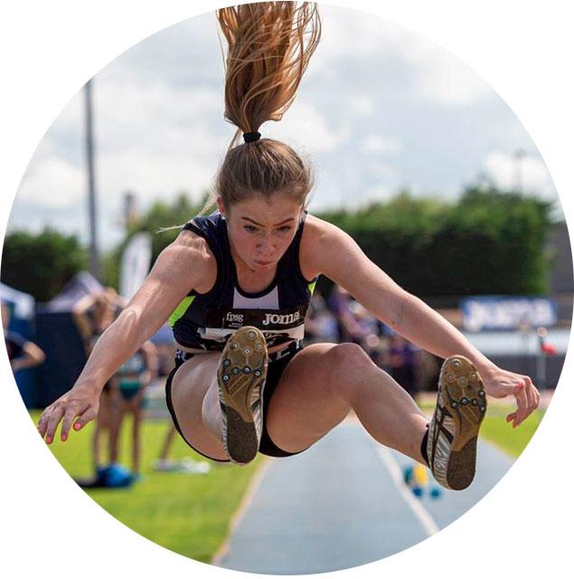 Girl doing long jump
